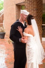 Carolina Club, Chapel Hill, NC: Kissing her sailor husband in the rain