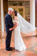 Carolina Club, Chapel Hill, NC: One of my favorite wedding portrait kisses ever, from her veil to the American flag in the background