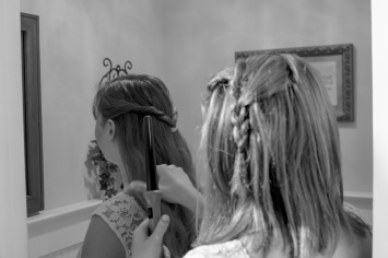 Christ Baptist Church Wedding, Raleigh NC: Bridesmaids retouching each others hair