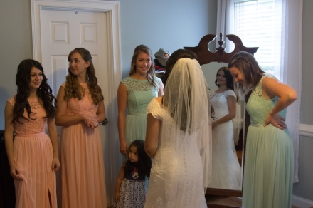 Christ Baptist Church Wedding, Raleigh NC: Greeting her bridesmaids