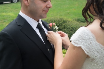 Christ Baptist Church Wedding, Raleigh NC: Pinning on the boutonniere