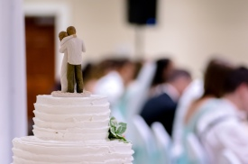 Christ Baptist Church Wedding, Raleigh NC: Cake topper and bride in the background