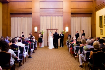 Carolina Club, Chapel Hill, NC: The happy couple at the altar, accented by lilies