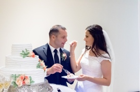 Christ Baptist Church Wedding, Raleigh NC: Irina feeds Costel wedding cake